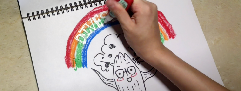 "Hand drawing a picture of a smiling oak tree with a rainbow above that says ""diversity"""